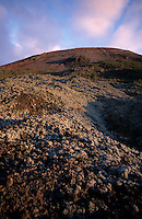 Rocky volcanic slopes of Mount Vesuvius at sunset, Naples, Italy.