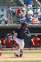 Charleston River Dogs designated hitter Estevan Florial (8) at bat during a game against the Lakewood BlueClaws at Joseph P. Riley, Jr. Ballpark on May 3, 2017 in Charleston, South Carolina. Lakewood defeated Charleston 11-6. (Robert Gurganus/Four Seam Images)