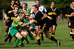 Bombay 2nd Five C. McRobbie is confronted by Z. Longford. Counties Manukau Premier Club Rugby, Drury vs Bombay played at the Drury Domain, on the 14th of April 2006. Bombay won 34 - 13.