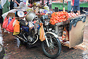 A motorcycle with a sidecar used as a fruit market stand in Chinatown. Kuala Lumpur, Selangor, Malaysia