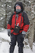 Hiker on the Mount Tecumseh during the winter months. Located in the White Mountains, New Hampshire USA