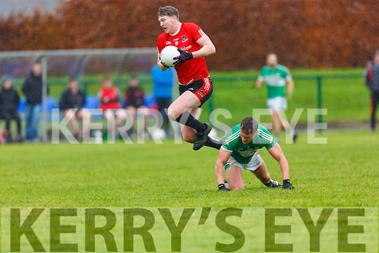 Cian O'Shea Fossa jumps over Denis Sheahan  Legion  during the East Kerry QF in Direen on Sunday