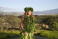 Female (wahine) hula dancer deep in thought, wearing palapalai fern head lei, headshot.