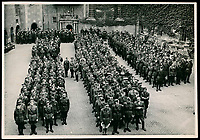 BNPS.co.uk (01202 558833)<br /> Pic: Warwick&Warwick/BNPS<br /> <br /> A role call at Colditz<br /> <br /> Spot the dummy (forth left) - One image is of a dummy they would hold up to trick the German guards into believing the escaper was still with them during parade head counts.<br /> <br /> A remarkable archive of photos which provide a glimpse inside the infamous Colditz Castle has come to light.<br /> <br /> The photos show the ingenuity of the Allied POWs who devised ever-bolder ways to escape from the German stronghold during World War Two.<br /> <br /> The photos were taken by the official Colditz photographer Johannes Lange, who was employed by the German Army to take pictures of failed Allied escape attempts. They were then distributed to other POW camps to alert the guards to the methods the inmates were using in their bids for freedom.<br /> <br /> The archive is being sold by a private collector with auctioneer Warwick & Warwick, with an estimate of £1,750.
