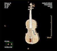 BNPS.co.uk (01202 558833)<br /> Picture: HAldridge/BNPS<br /> <br /> ****Please use full byline****<br /> <br /> The violins CT Scan from the hospital to prove it's authenticity. <br /> <br /> The violin played by the bandmaster on the Titanic as the ship was sinking is finally being auctioned for an estimated &pound;400,000.<br /> <br /> The wooden instrument has been proven to be the one used by Wallace Hartley as his band famously played on to help keep the passengers calm during the disaster.<br /> <br /> Its existence and survival only emerged in 2006 when the son of an amateur violinist who was gifted it by her music teacher in the early 1940s contacted an auctioneers.