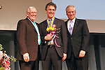 Len Cariou, Thomas J. Dart, and Jeremy Travis pose on stage, at the John Jay Justice Award ceremony, April 5 2011.