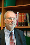 Dr Jean-Pierre Droz, Oncology unit, Centre Leon Berard, Lyon, France. The doctor in his office surrounded by books. Portrait.