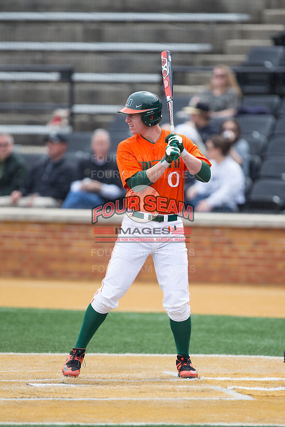 Zack Collins (0) of the Miami Hurricanes at bat against the Wake Forest Demon Deacons at Wake Forest Baseball Park on March 22, 2015 in Winston-Salem, North Carolina.  The Demon Deacons defeated the Hurricanes 10-4.  (Brian Westerholt/Four Seam Images)