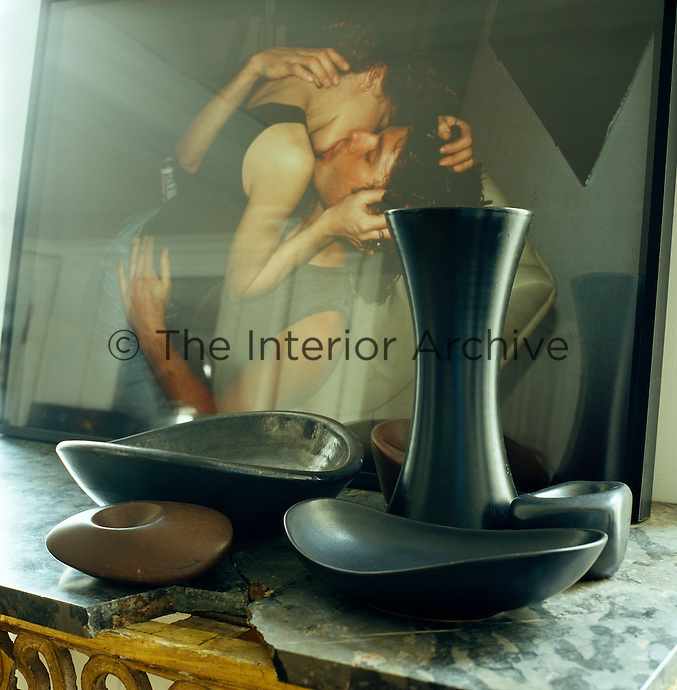 Detail of black ceramics and a photograph by Cindy Sherman in the living room