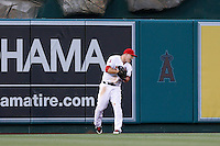 Mike Trout #27 of the Los Angeles Angels shows his anger after failing to catch a home run during a game against the St. Louis Cardinals at Angel Stadium on July 3, 2013 in Anaheim, California. (Larry Goren/Four Seam Images)