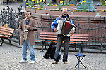 Street Musicians.  Frankfurt, Germany  The market square of Frankfurt is a gathering place of locals and tourist, surrounded by historic buildings.