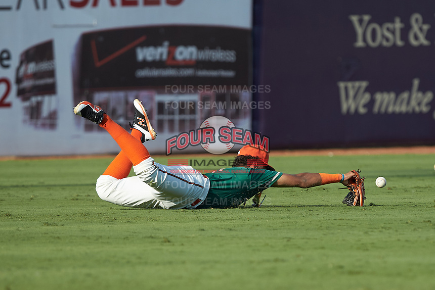 Greensboro Grasshoppers left fielder Ricardo Cespedes (7) can't make a diving catch during the game against the West Virginia Power at First National Bank Field on August 9, 2018 in Greensboro, North Carolina. The Power defeated the Grasshoppers 5-3 in game one of a double-header. (Brian Westerholt/Four Seam Images)