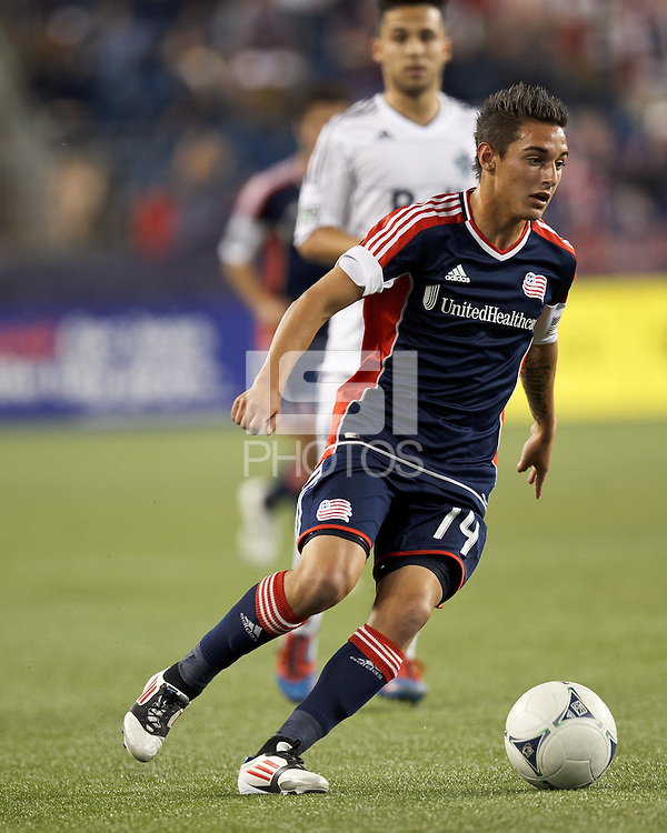 New England Revolution forward Diego Fagundez (14) dribbles. In a Major League Soccer (MLS) match, the New England Revolution defeated Vancouver Whitecaps FC, 4-1, at Gillette Stadium on May 12, 2012.