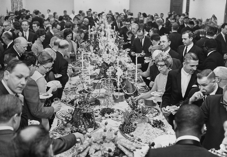 Rep. Wright Patman, D-Tex., Chairman of House Banking and Currency committee, at a ceremony and reception in Washington, D.C., with a view of the buffet table and a portion of the guests at the Patman reception in the Rayburn House Office Building on March 5, 1968. (Photo by CQ Roll Call)