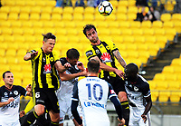 Dylan Fox and Tom Doyle go up for a corner during the A-League football match between Wellington Phoenix and Melbourne Victory at Westpac Stadium in Wellington, New Zealand on Friday, 10 January 2018. Photo: Dave Lintott / lintottphoto.co.nz