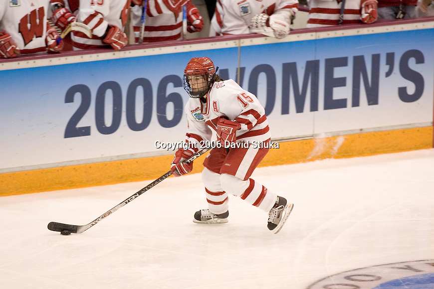 MINNEAPOLIS, MN - MARCH 26: Sara Bauer #15 of the Wisconsin Badgers women's hockey handles the puck against the Minnesota Golden Gophers at Mariucci Arena during the Women's Frozen Four Tournament final on March 26, 2006 in Minneapolis, Minnesota. The Badgers beat the Gophers 3-0. (Photo by David Stluka)