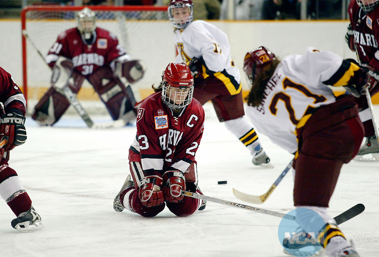 28 MAR 2004:  Lauren McAuliffe (23) of Harvard dips down to block a shot by Allie Sanchez (21) of Minnesota during the Division I Women's Ice Hockey Championship held at the Dunkin Donuts Center in Providence, RI.  Minnesota defeated Harvard 6-2 for the national title.  Jamie Schwaberow/NCAA Photos