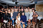 Siobhan Ryan of Ballymac and Dean Reidy from Killorglin, seated front, celebrate their engagement with their family and friends in Benners Hotel last Friday night.