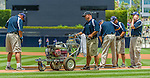 23 June 2013: The San Diego Padres Grounds Crew paint the first base line prior to a game against the Los Angeles Dodgers at Petco Park in San Diego, California. The Dodgers defeated the Padres 3-1, splitting their 4-game Divisional Series at 2-2. Mandatory Credit: Ed Wolfstein Photo *** RAW (NEF) Image File Available ***