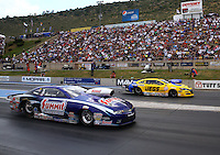 Jul. 20, 2014; Morrison, CO, USA; NHRA pro stock driver Jason Line (near lane) races alongside Jeg Coughlin Jr during the Mile High Nationals at Bandimere Speedway. Mandatory Credit: Mark J. Rebilas-