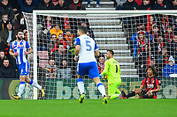 Will Grigg of Wigan Athletic left celebrates scoring the first goal as Artur Boruc of AFC Bournemouth and Dan Gosling of AFC Bournemouth look dejected during AFC Bournemouth vs Wigan Athletic, Emirates FA Cup Football at the Vitality Stadium on 6th January 2018
