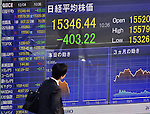December 4, 2013, Tokyo, Japan - A pedestrian scurries past the electric stock price board of a local brokerage as stock prices take a plunge during the morning session on the Tokyo Stock Exchange market Wednesday, December 4, 2013. The Nikkei 225 Stock Average dropped as much as 403.22 points one time to 15346.44, the lowest level since November 22, 2013.  (Photo by Natsuki Sakai/AFLO)