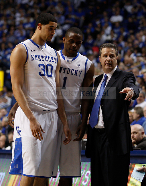 Seniors Eloy Vargas and Darius Miller talk with head coach John Calipari near the end of the game against the University of Georgia, at Rupp Arena, on March 1, 2012. UK won 79-49. Photo by Latara Appleby | Staff ..