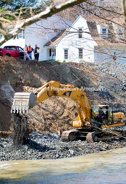 WOODBURY, CT. 30 April 2007-043007SV01--A crew works to stabilize the bank of the Pomperaug River next to a home at 10 Orton Road in Woodbury Monday.<br /> Steven Valenti Republican-American