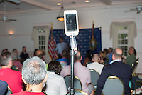 """An Apple iPhone live-streams the event Republican presidential candidate Bobby Jindal speaks to people gathered at his """"Believe Again"""" campaign event at the Governor's Inn and Restaurant in Rochester, New Hampshire. Jindal is campaigning in New Hampshire in advance of the 2016 Republican presidential primary there."""