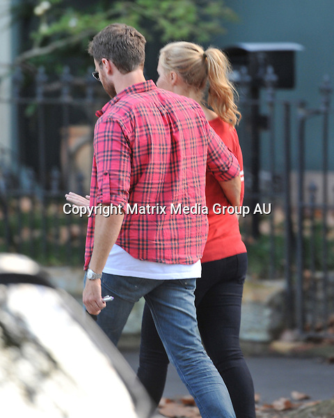 29 MAY 2013 SYDNEY AUSTRALIA<br /> <br /> EXCLUSIVE PICTURES<br /> <br /> Actor Josh Lawson pictured outside the Park Hyatt Hotel proving you can do two things at once as he hugs his girlfriend and sends a text at the same time.
