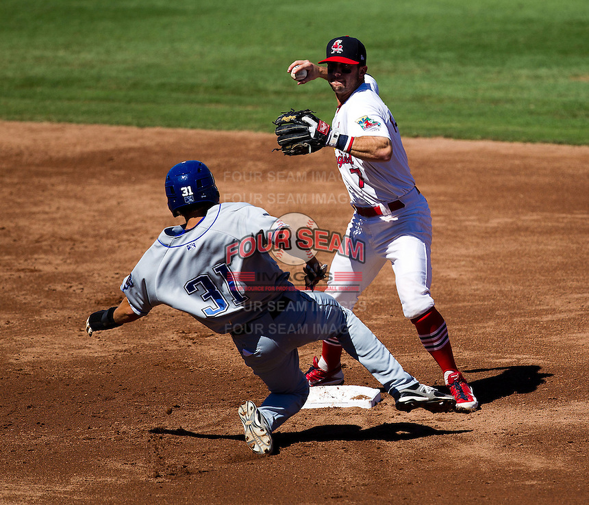 Greg Garcia (7) of the Springfield Cardinals turns a double play during a game against the Tulsa Drillers at Hammons Field on September 9, 2012 in Springfield, Missouri. (David Welker/Four Seam Images)