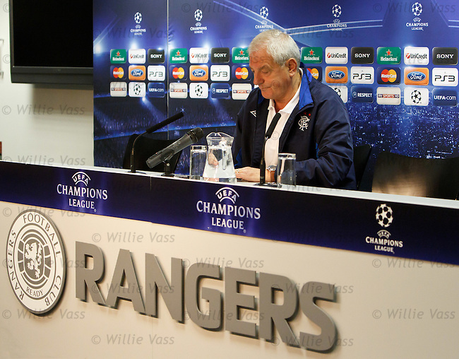 Walter Smith faces the media at Ibrox Stadium for the UEFA Champions League press conference and he checks his notes