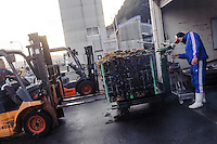 A forklift truck moves a cage of wakame for weighing, harvesting wakame at dawn, Awata fishing port, Naruto, Tokushima Prefecture, Japan, February 4, 2012.