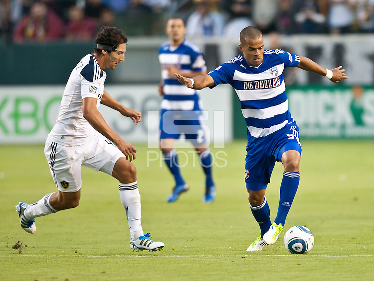CARSON, CA – August 6, 2011: FC Dallas forward Maicon Santos (9) and LA Galaxy defender Omar Gonzalez (4) during the match between LA Galaxy and FC Dallas at the Home Depot Center in Carson, California. Final score LA Galaxy 3, FC Dallas 1.