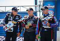 Sep 4, 2016; Clermont, IN, USA; NHRA funny car driver John Force (left), Tim Wilkerson (center) and Robert Hight during qualifying for the US Nationals at Lucas Oil Raceway. Mandatory Credit: Mark J. Rebilas-USA TODAY Sports