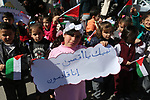 Palestinian children hold banners during a protest against U.S. President Donald Trump's decision to recognise Jerusalem as the capital of Israel, in front of the high commissioner for human rights headquarters, in Gaza city on February 28, 2018. Photo by Ashraf Amra