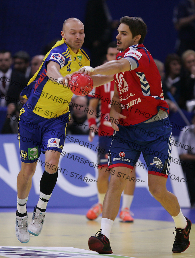 BELGRADE, SERBIA - JANUARY 23: Henrik Lundstrom (L) of Sweden fight for the ball with Nikola Manojlovic (L) of Serbia during the Men's European Handball Championship 2012 second round  group one, match between Serbia and Sweden at Arena Hall on January 23, 2012 in Belgrade, Serbia. (Photo by Srdjan Stevanovic/Starsportphoto.com ©)