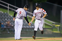 Kannapolis Intimidators manager Justin Jirschele (9) slaps hands with Seby Zavala (21) as he rounds third base after hitting a home run against the Asheville Tourists at Kannapolis Intimidators Stadium on May 5, 2017 in Kannapolis, North Carolina.  The Tourists defeated the Intimidators 5-1.  (Brian Westerholt/Four Seam Images)