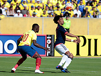 QUITO - ECUADOR - 28 - 03 - 2017: Walter Ayovi (Izq.) jugador de Ecuador disputa el balón con Juan G. Cuadrado (Der.) jugador de Colombia, durante partido de la fecha 14 entre los seleccionados de Ecuador y Colombia, por la clasificación a la Copa Mundo FIFA 2018 Rusia jugado en el estadio Olímpico Atahualpa en la ciudad de Quito. / Walter Ayovi (L) player of Ecuador struggles the ball with Juan G. Cuadrado (R) player of Colombia, during a match of the date 14 between the teams of Ecuador and Paraguay by the classification to the 2018 FIFA World Cup Russia played in the Olympic Stadium Atahualpa in the city of Quito. Photo: VizzorImage / Rolando Enriquez / Agencia Cronistas Gráficos / Cont.