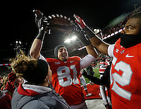 Ohio State Buckeyes tight end Nick Vannett (81) hoists the Illibuck trophy following Ohio State's 55-14 win over Illinois in the NCAA football game at Ohio Stadium on Nov. 1, 2014. (Adam Cairns / The Columbus Dispatch)