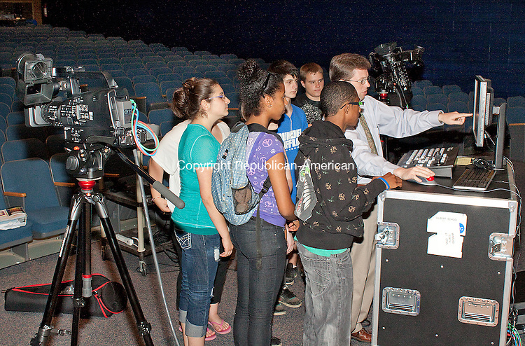 WINSTED, CT- JUNE 07 2011-060712DA02-  Art teacher for Gilbert School in Winsted Jason Crouch instructs students how to use new video production equipment on Thursday. Students won a $68,000 grant that has allowed the school to purchase the equipment that will be used to broadcast live events like town meetings and graduations on Charter Communications public access Channel 14 and start a new video production class next year..Darlene Douty Republican American