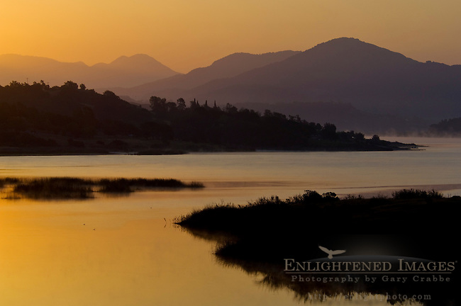 Morning sunrise light over Lake Casitas and rolling hills near Ojai, California