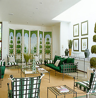 The focus of the pool room is the decorative topiary screen complemented by Empire-style wrought-iron furniture