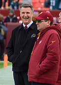 Washington Redskins team president Bruce Allen, left and owner Daniel M. Snyder, right, converse prior to the game against the Philadelphia Eagles at FedEx Field in Landover, Maryland on December 30, 2018.<br /> Credit: Ron Sachs / CNP