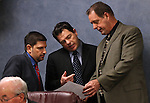 Nevada Sens. Mark Manendo, D-Las Vegas, Michael Roberson, R-Las Vegas, and John Lee, D-North Las Vegas, talk before a committee hearing on Friday, April 15, 2011, at the Legislature in Carson City, Nev. .Photo by Cathleen Allison