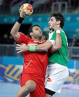 Algeria's Riad Chehbour (r) and Egypt's Mohamed Alaa during 23rd Men's Handball World Championship preliminary round match.January 15,2013. (ALTERPHOTOS/Acero) /NortePhoto