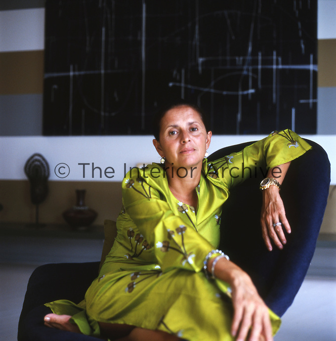 Portrait of designer Muriel Brandolini in a lime green kaftan