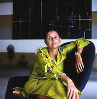 Portrait of designer Muriel Brandolini in a lime green kaftan