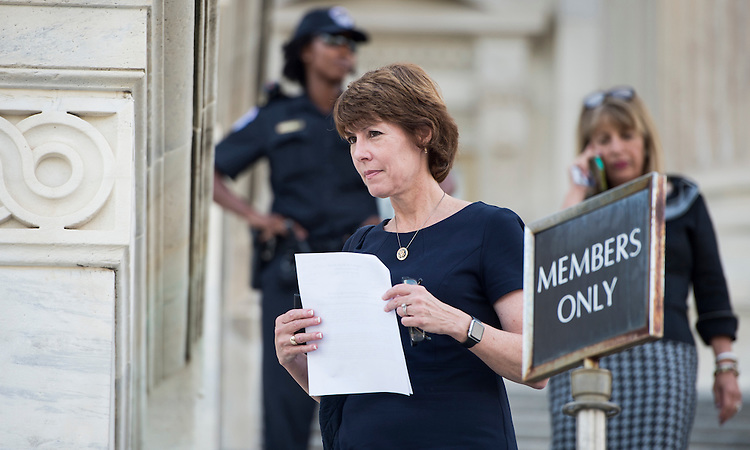 UNITED STATES - JULY 29: Rep. Gwen Graham, D-Fla.,  walks down the House steps at the Capitol following the final votes before the August recess on Wednesday, July 29, 2015. (Photo By Bill Clark/CQ Roll Call)