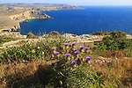 Coastal scenery of cliffs and blue sea looking south from Res il-Qammieh, Marfa Peninsula, Republic of Malta